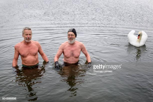 Gustav Meierl and his brother Waldemar Meierl swim in a lake near Biebesheim am Rhein in minus 2 degrees Celcius air temperature on March 19 2018 in...