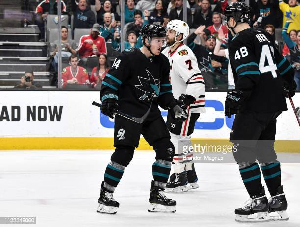 Gustav Nyquist and Tomas Hertl of the San Jose Sharks celebrate a goal against the Chicago Blackhawks at SAP Center on March 28 2019 in San Jose...