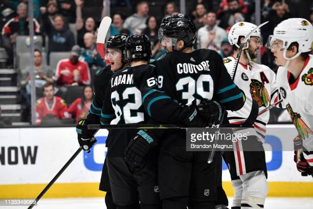Gustav Nyquist Logan Couture and Kevin Labanc of the San Jose Sharks celebrate a goal against the Chicago Blackhawks at SAP Center on March 28 2019...