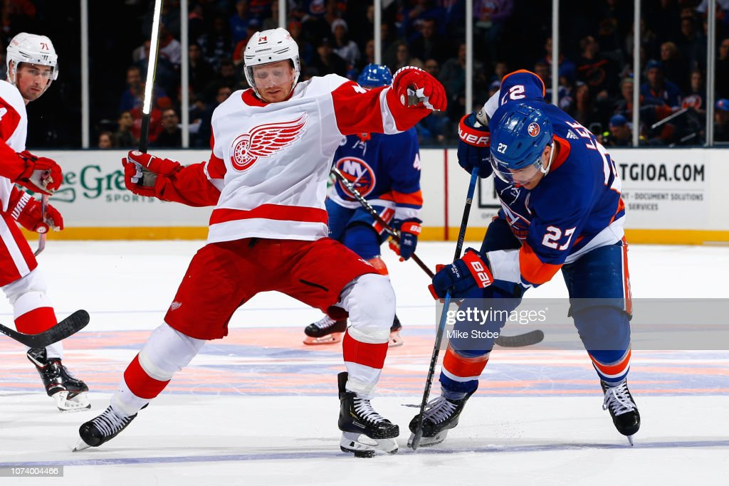 aca54df6aef Gustav Nyquist of the Detroit Red Wings and Anders Lee of the New ...