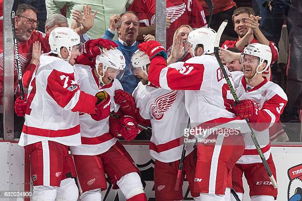 Gustav Nyquist of the Detroit Red Wings celebrates his third period goal with teammates Dylan Larkin Tomas Tatar Xavier Ouellet and Nick Jensen...
