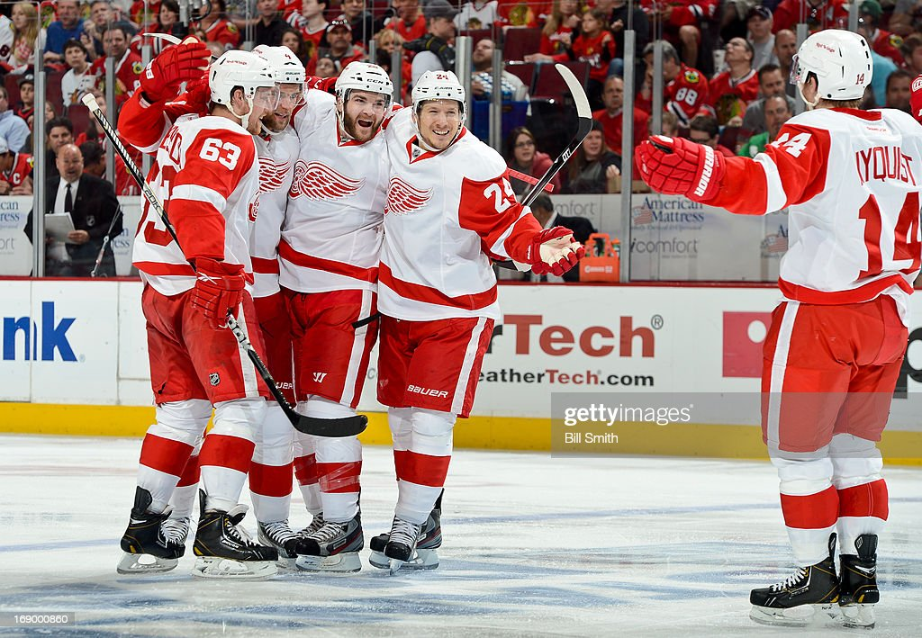 Gustav Nyquist #14 of the Detroit Red Wings skates in to celebrate with teammates (L-R) Joakim Andersson #63, Jakub Kindl #4, Carlo Colaiacovo #28 and Damien Brunner #24 after Brunner scored against the Chicago Blackhawks in the second period in Game Two of the Western Conference Semifinals during the 2013 Stanley Cup Playoffs at the United Center on May 18, 2013 in Chicago, Illinois.