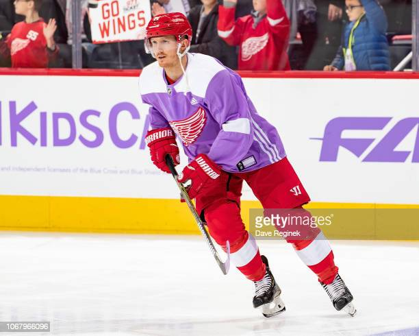 Gustav Nyquist of the Detroit Red Wings skates in warm-ups with his custom Hockey Fights Cancer jersey prior to an NHL game against the Arizona...