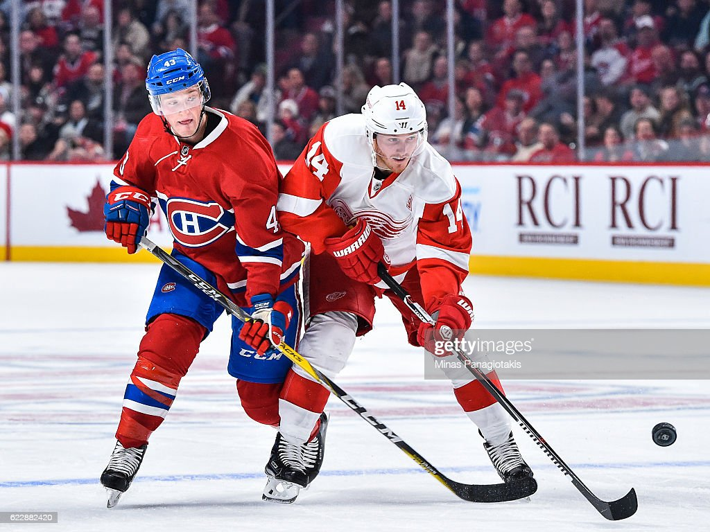 Gustav Nyquist #14 of the Detroit Red Wings skates the puck against Daniel Carr #43 of the Montreal Canadiens during the NHL game at the Bell Centre on November 12, 2016 in Montreal, Quebec, Canada. The Montreal Canadiens defeated the Detroit Red Wings 5-0.