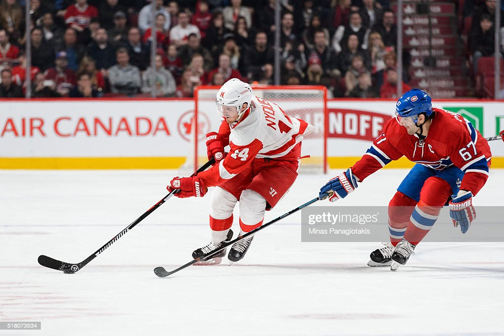 Gustav Nyquist #14 of the Detroit Red Wings skates the puck against Max Pacioretty #67 of the Montreal Canadiens during the NHL game at the Bell Centre on March 29, 2016 in Montreal, Quebec, Canada. The Montreal Canadiens defeated the Detroit Red Wings 4-3.