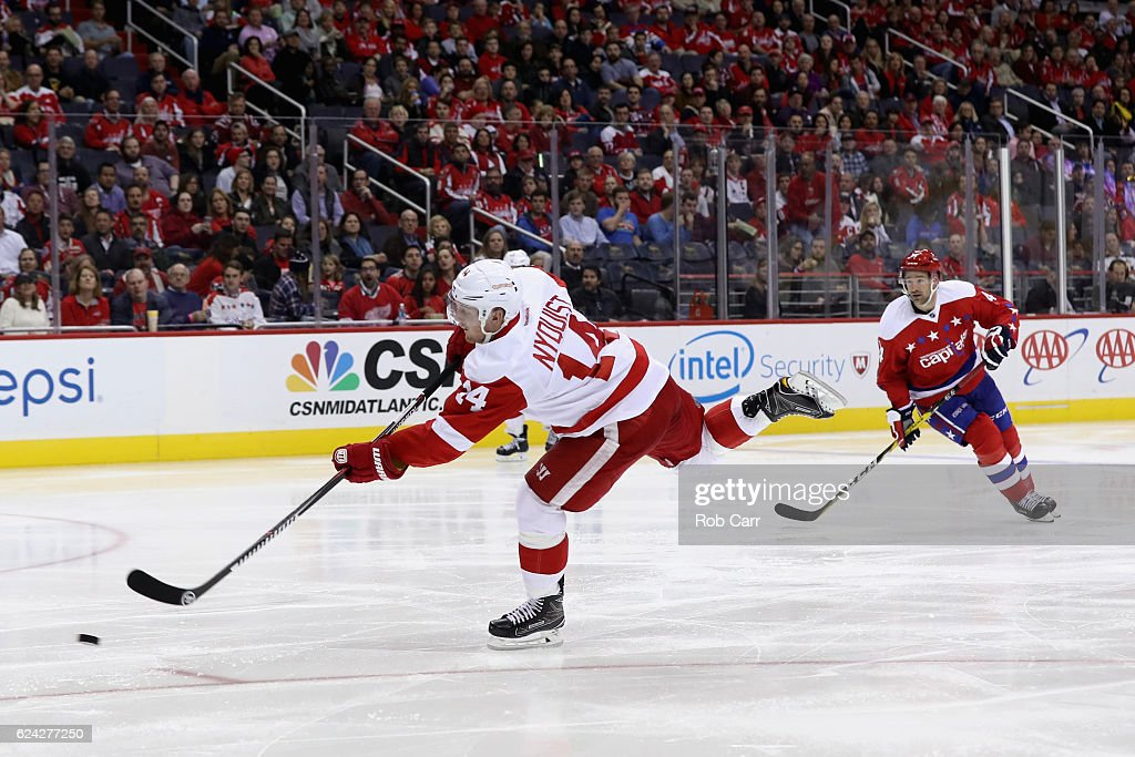 Gustav Nyquist #14 of the Detroit Red Wings takes a shot on goal in the third period against the Washington Capitals at Verizon Center on November 18, 2016 in Washington, DC.