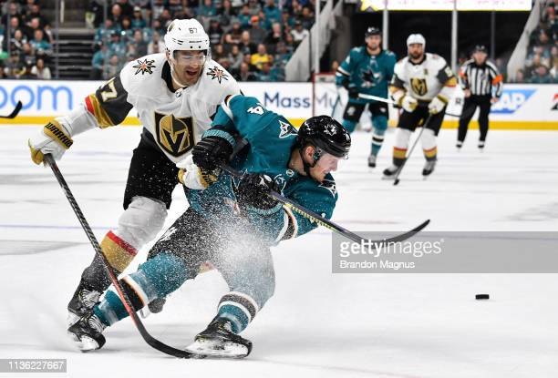 Gustav Nyquist of the San Jose Sharks battles for the puck against Max Pacioretty of the Vegas Golden Knights in Game One of the Western Conference...