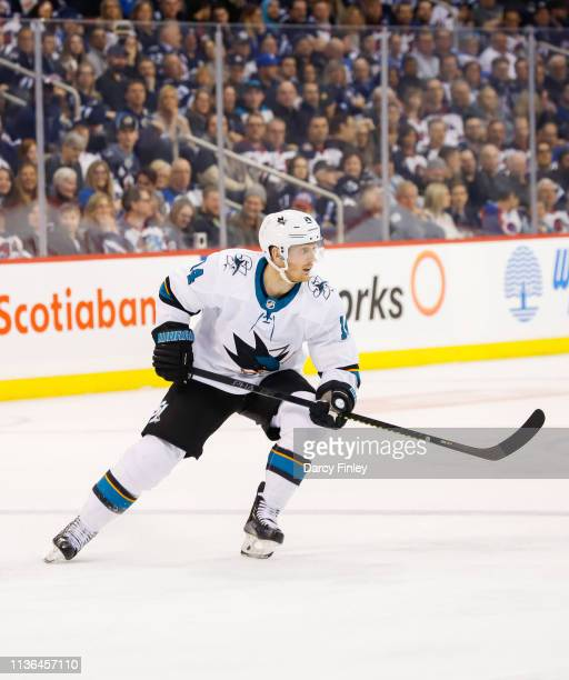Gustav Nyquist of the San Jose Sharks keeps an eye on the play during second period action against the Winnipeg Jets at the Bell MTS Place on March...
