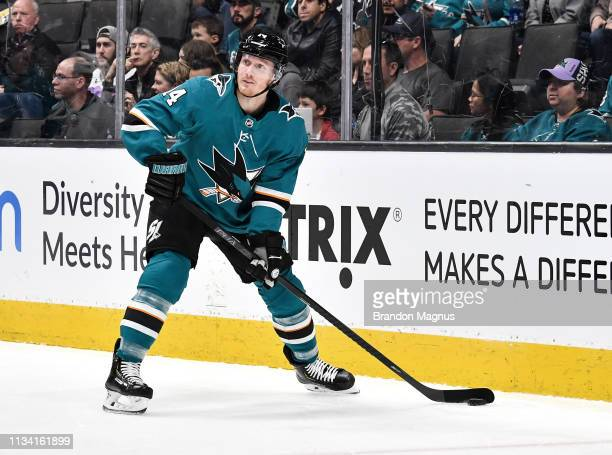 Gustav Nyquist of the San Jose Sharks skates ahead with the puck against the Calgary Flames at SAP Center on March 31 2019 in San Jose California