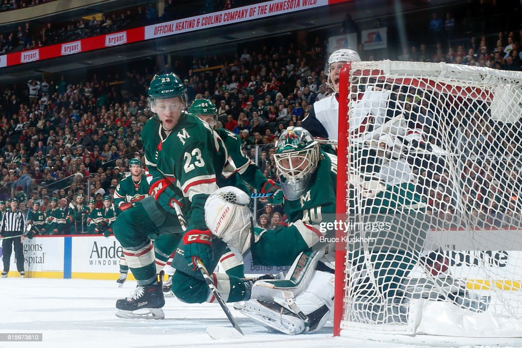 Gustav Olofsson #23 and goalie Devan Dubnyk #40 of the Minnesota Wild defend their goal against the Arizona Coyotes during the game at the Xcel Energy Center on February 8, 2018 in St. Paul, Minnesota.