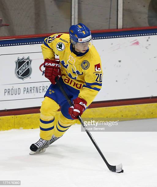 Gustav Possler of Team Sweden skates against Team USA during the 2013 USA Hockey Junior Evaluation Camp at the Lake Placid Olympic Center on August 7...