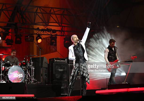 Gustav Schaefer Bill Kaulitz and Georg Listing of the band Tokio Hotel perform at the Brandenburg Gate New Years Eve Party on December 31 2014 in...