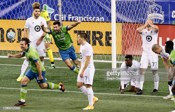 Gustav Svensson of Seattle Sounders and Will Bruin celebrate the winning goal against the Minnesota United in the second half during the Western...