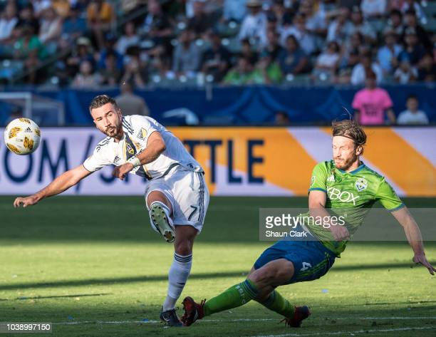 Gustav Svensson of Seattle Sounders blocks a shot by Romain Alessandrini of Los Angeles Galaxy during the Los Angeles Galaxy's MLS match against...