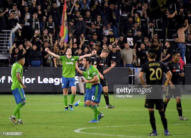 Gustav Svensson of Seattle Sounders celebrates a 3-1 win next to Walker Zimmerman of Los Angeles FC during the Western Conference finals at Banc of...