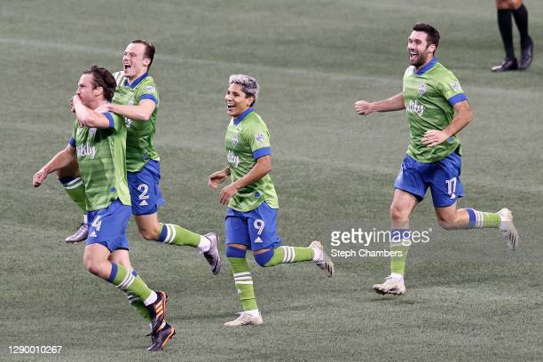Gustav Svensson of Seattle Sounders celebrates his winning goal with Brad Smith, Raul Ruidiaz and Will Bruin against the Minnesota United in the...