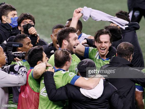Gustav Svensson of Seattle Sounders waves a shirt as he celebrates with his teammates after their 3-2 win against the Minnesota United during the...