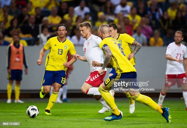 Gustav Svensson of Sweden and Nicolai Jorgensen of Denmark during the International Friendly match between Sweden and Denmark at Friends Arena on...