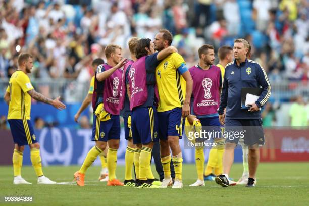 Gustav Svensson of Sweden consoles teammate Andreas Granqvist following their sides defeat in the 2018 FIFA World Cup Russia Quarter Final match...