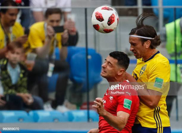 Gustav Svensson of Sweden national team and Blerim Dzemaili of Switzerland national team vie for a header during the 2018 FIFA World Cup Russia Round...