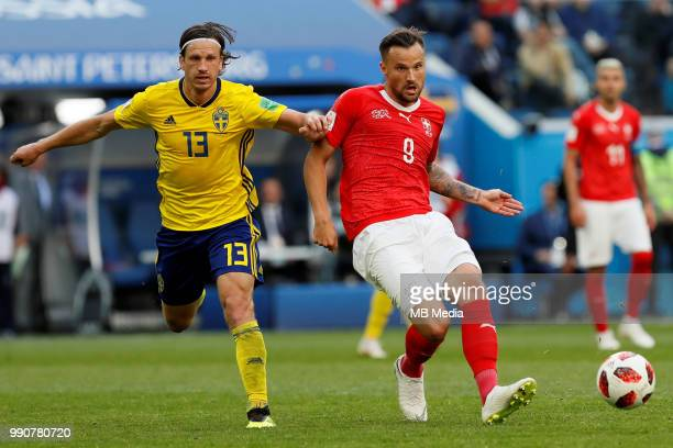 Gustav Svensson of Sweden national team and Haris Seferovic of Switzerland national team vie for the ball during the 2018 FIFA World Cup Russia Round...