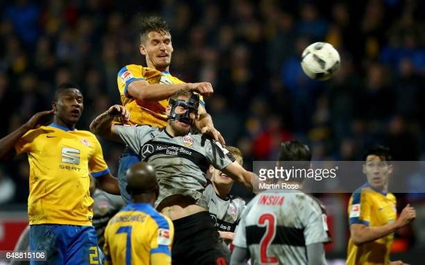 Gustav Valsvik of Braunschweig and Simon Terodde of Stuttgart jump to head for the ball during the Second Bundesliga match between Eintracht...