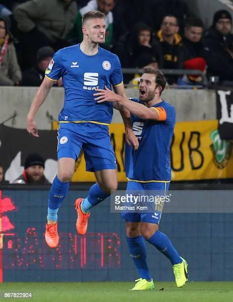 Gustav Valsvik of Braunschweig jubilates with team mate Ken Reichel after scoring the second goal during the Second Bundesliga match between SG...