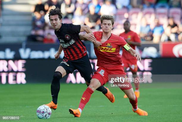 Gustav Wikheim of FC Midtjylland and Mathias Jensen of FC Nordsjælland compete for the ball during the Danish Alka Superliga match between FC...