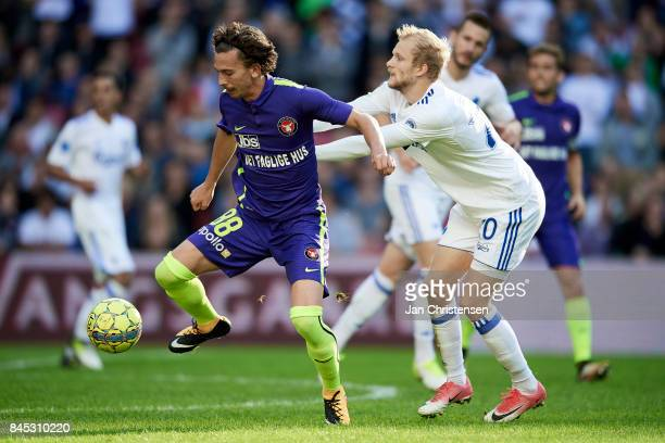 Gustav Wikheim of FC Midtjylland and Nicolai Boilesen of FC Copenhagen compete for the ball during the Danish Alka Superliga match between FC...