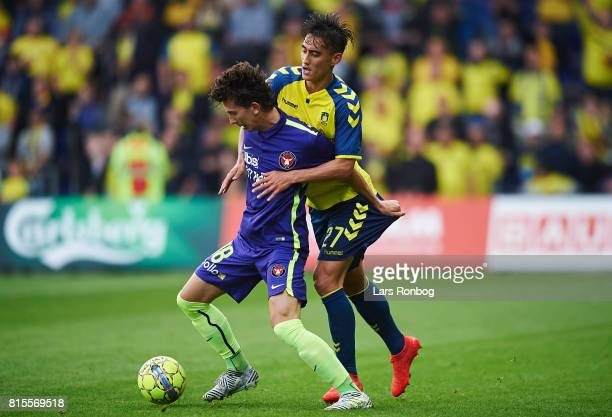 Gustav Wikheim of FC Midtjylland and Svenn Crone of Brondby IF compete for the ball during the Danish Alka Superliga match between Brondby IF and FC...