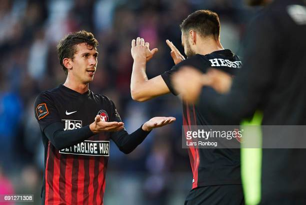 Gustav Wikheim of FC Midtjylland leaving the pitch shaking hands with Tim Sparv of FC Midtjylland during the Danish Alka Superliga Europa League...