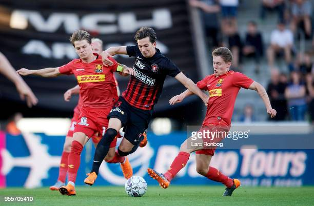 Gustav Wikheim of FC Midtjylland Mathias Jensen of FC Nordsjælland and Magnus Kofod Andersen of FC Nordsjælland compete for the ball during the...