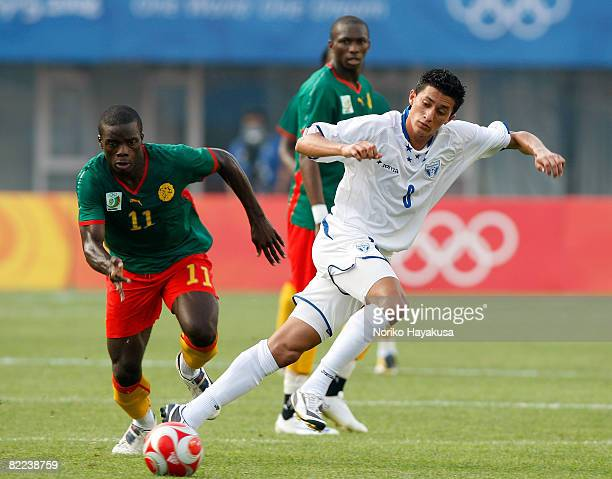 Gustave Bebbe of Cameroon and Rigoberto Padilla of Honduras compete for the ball during the Men's Group D match between Cameroon and Honduras on Day...