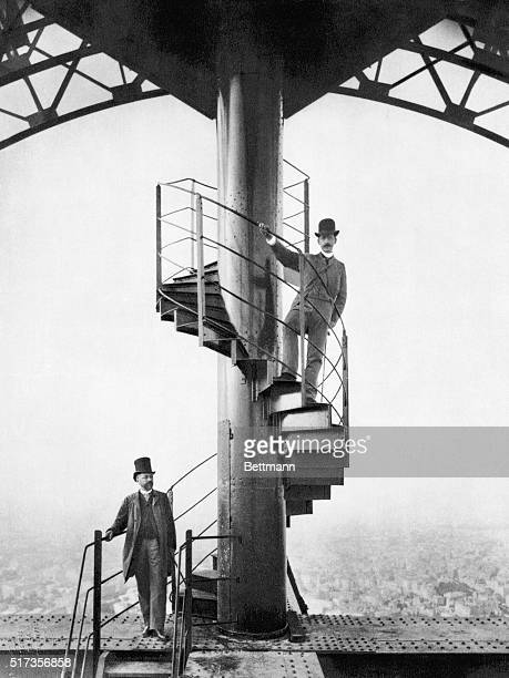 Gustave Eiffel and a friend explore the newly built Eiffel Tower in Paris in 1889 the year of the Centennial Exposition for which it was built The...