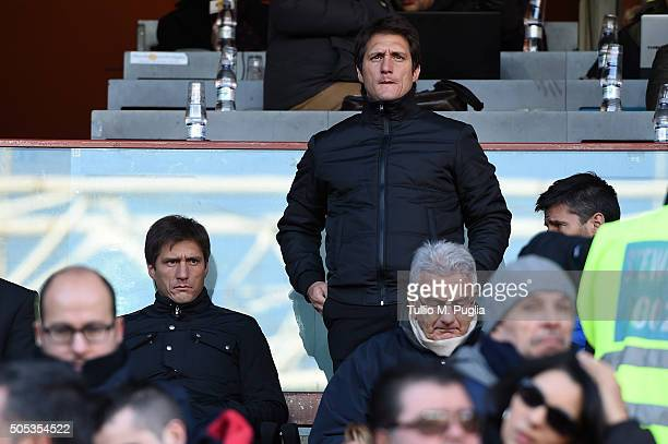 Gustavo and Guillermo Barros Schelotto of US Citta' di Palermo look on in the VIP standing during the Serie A match between Genoa CFC and US Citta di...