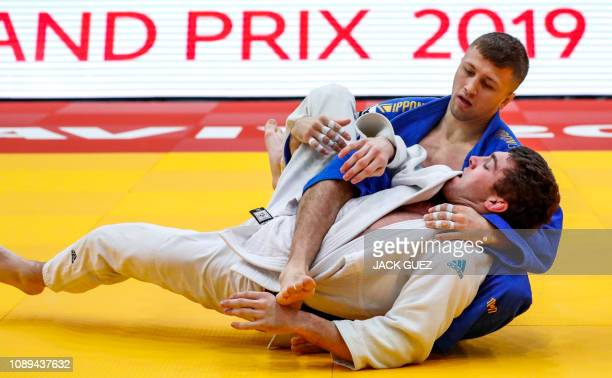 Gustavo Assis of Brazil competes against Mohab ElNahas of Canada during their men's under 90 kg weight category match at the Tel Aviv Grand Prix 2019...