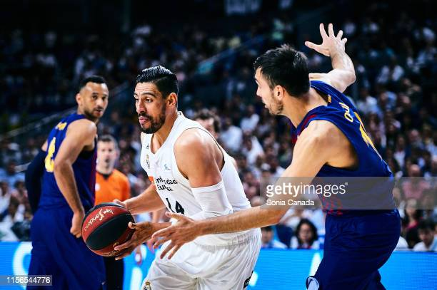 Gustavo Ayon #14 center of Real Madrid in action during the final of the Liga ACB match between Real Madrid and Barcelona at Wizink Center on June 17...