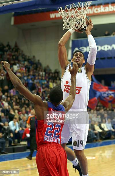 Gustavo Ayon #14 of Real Madrid competes with Cory Higgins #22 of CSKA Moscow in action during the Turkish Airlines Euroleague Basketball Top 16...