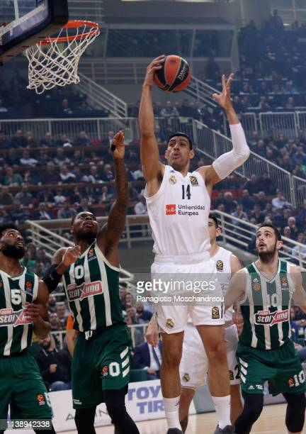 Gustavo Ayon #14 of Real Madrid competes with Deshaun Thomas #0 of Panathinaikos OPAP Athens during the Turkish Airlines EuroLeague Play Off game 3...