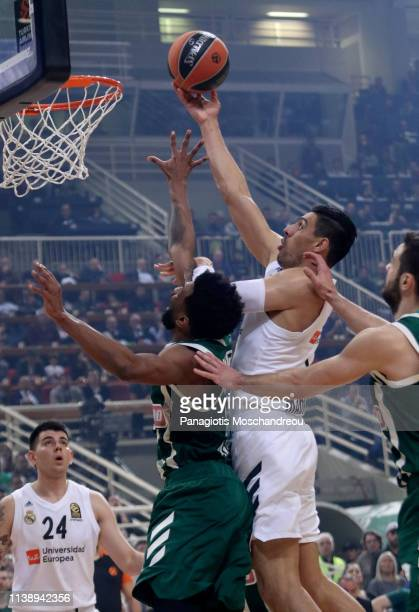 Gustavo Ayon #14 of Real Madrid competes with Keith Langford #5 of Panathinaikos OPAP Athens during the Turkish Airlines EuroLeague Play Off game 3...
