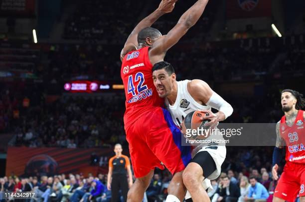 Gustavo Ayon #14 of Real Madrid competes with Kyle Hines #42 of CSKA Moscow during 2019 Turkish Airlines EuroLeague Final Four Semifinal B game...
