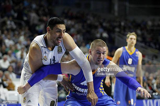 Gustavo Ayon #14 of Real Madrid competes with Paul Davis #40 of Khimki Moscow Region during the Turkish Airlines Euroleague Regular Season Round 6...