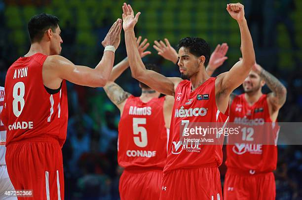 Gustavo Ayon and Jorge Gutierrez of Mexico celebrate during a second stage match between Venezuela and Mexico as part of the 2015 FIBA Americas...