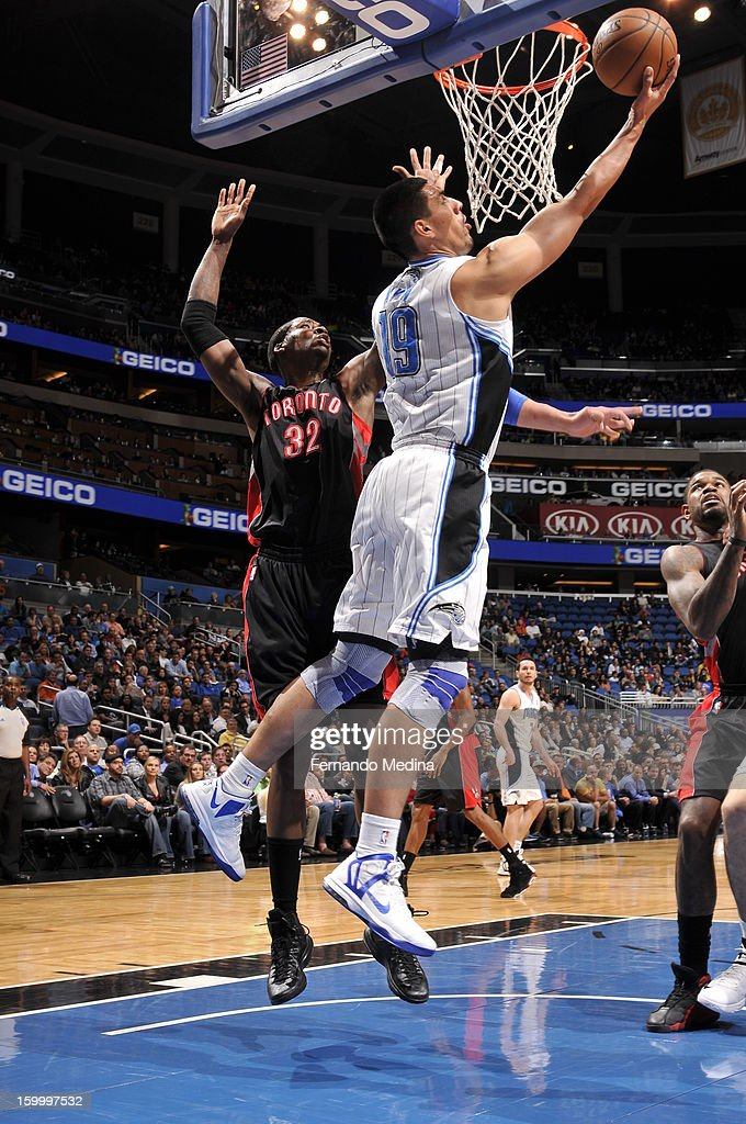 Gustavo Ayon #19 of the Orlando Magic attempts a reverse layup against the Toronto Raptors during the game on January 24, 2013 at Amway Center in Orlando, Florida.
