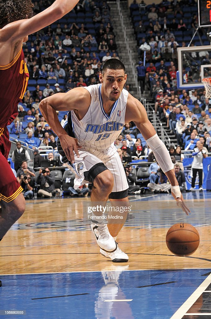 Gustavo Ayon #19 of the Orlando Magic drives to the basket against the Cleveland Cavaliers on November 23, 2012 at Amway Center in Orlando, Florida.