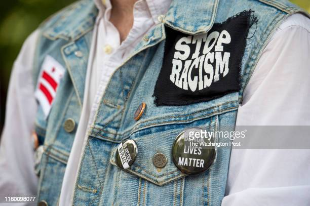 Gustavo Berrizbeitia wears a jacket with antiracist pins at a rally against white supremacy in Lafayette Square on August 6 2019 in Washington DC