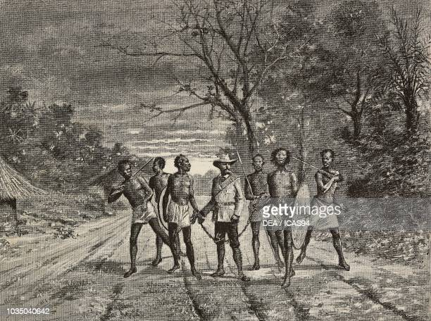 Gustavo Bianchi Italian explorer chained with an indigenous Shanqella Ethiopia engraving from a drawing by E Ximenes from the book Alla Terra dei...
