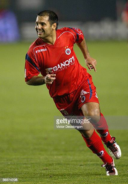 Gustavo Biscayzacu of Veracruz smiles after scoring a goal in the first half against Morelia during Interliga 2006 a qualification tournament for...