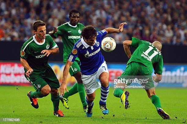Gustavo Boccoli of Haifa and team mate Idan Vered challenge Raul Gonzalez of Schalke during the UEFA Europa League group J match between FC Schalke...