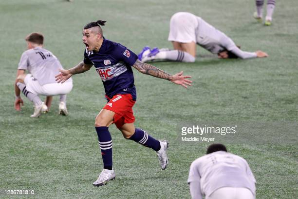 Gustavo Bou of New England Revolution celebrates after scoring the game winning goal against the Montreal Impact during second half of the Play-In...